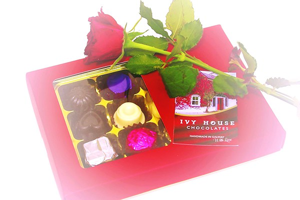 Ivy House Chocloates logo with decorative display of choclates and flowers