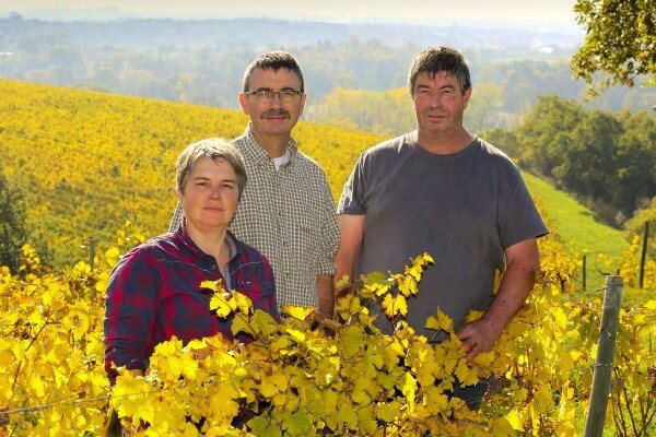 Photo of the Vaillant family standing in their vineyard.