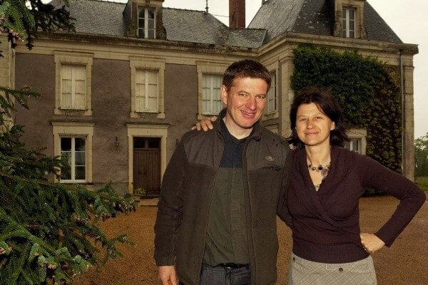 The owners of Château de Bellevue outside of the main house on the parkland.